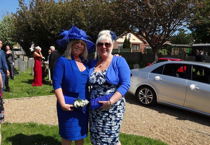 Loving my hat with my sister on the occasion of my daughters wedding